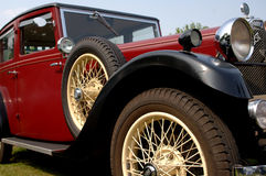 Classic Automobile. Classic red automobile with spoked wheels and chrome accents. Spoked wheel and spare are dominant features stock images