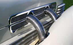 Classic Automobile Exhaust Pipes Detail. Classic Cord chrome external Super-Charged Exhaust Pipes- Detail of a replica Royalty Free Stock Photos