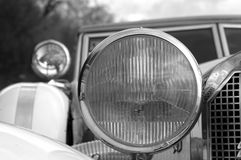 Classic automobile headlight. Classic automobile compartment and  headlight closeup Royalty Free Stock Images