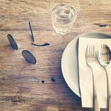 Classic background. Dining accessories on wooden table Stock Photos