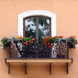 Classic balcony with flowers Royalty Free Stock Photo