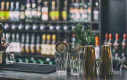 Classic bar counter. With bottles in blurred background Stock Images