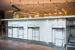 Classic bar counter interior with empty chairs Royalty Free Stock Photo