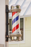 Classic Barber Pole on Wood Post Stock Image