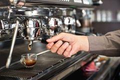 Classic barman hand preparing italian espresso at modern coffee Royalty Free Stock Photos