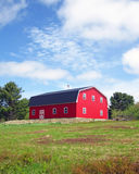 Classic Barn. A traditional classic red barn with a weathervane Stock Photo