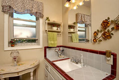 Classic bathroom. Classic styed bathroom shows the old style of tile used around the sink stock photography