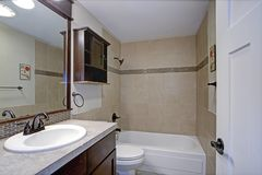Classic bathroom with beige tile royalty free stock images
