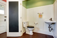 Classic bathroom interior with toilet and sink. Also green and white walls. Royalty Free Stock Photo