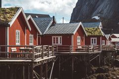 Classic and beautiful landscape of the Lofoten Islands with red fishermen`s houses in front of the sea and high royalty free stock image
