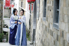 Classic beauty in China, best friends in Hanfu dress, drinking tea Royalty Free Stock Photo