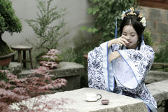 Classic beauty in China, woman in Hanfu dress, drinking tea Stock Photos