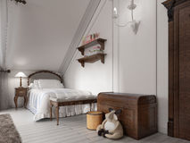Classic bed in a child's bedroom with night table, lamp and toy Royalty Free Stock Photography