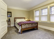 Classic bedroom with brown wooden bed Stock Photo
