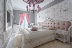 Classic bedroom with double bed, tv Royalty Free Stock Image