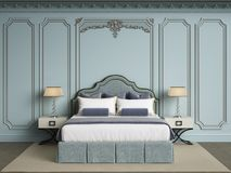 Classic bedroom furniture in classic interior.Walls with mouldin Stock Images