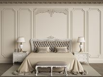 Classic bedroom furniture in classic interior.Walls with mouldin Royalty Free Stock Image