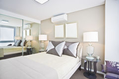 Classic bedroom of modern house with white Bed and pillows. Royalty Free Stock Photography