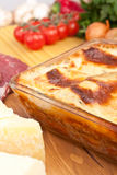 Classic Beef Lasagna. With Ingredients at the Back Royalty Free Stock Photography
