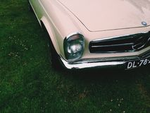 Classic Beige Car Parked on Green Grass Yard Stock Images