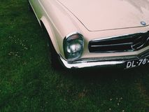 Classic Beige Car Parked on Green Grass Yard Stock Photos
