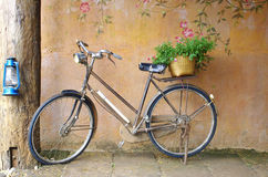 Classic bicycle. In front of art wall background Royalty Free Stock Photo