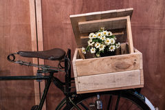 Classic bicycle with wooden box of flowers. Royalty Free Stock Images