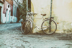 Classic bike leaning against the wall Royalty Free Stock Image