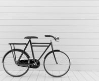 Classic black bike with white wall in 3D rendering Royalty Free Stock Photos