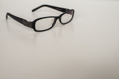 Classic black glasses on the table Royalty Free Stock Images