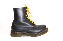 Classic black lace-up boot with yellow laces Royalty Free Stock Images