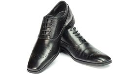 Classic black leather men`s shoes isolated on white background. Stock Photography