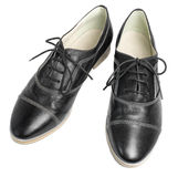 Classic black leather shoes with laces on white background. A pair of classic black leather shoes with laces on white background Stock Photography
