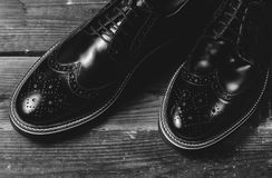 Classic black male shoes. On wooden background Royalty Free Stock Photography