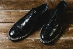 Classic black male shoes. On wooden background Royalty Free Stock Photo
