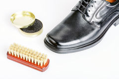 Classic black men's shoe, boot polish and brush Royalty Free Stock Photos
