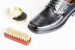 Classic black men's shoe, boot polish and brush Royalty Free Stock Photos