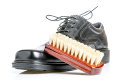 Classic black men's shoe and brush Royalty Free Stock Image