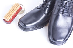Classic black men's shoes, boot polish and brush Royalty Free Stock Photo