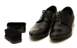 Classic black men's shoes with sponge on white Royalty Free Stock Photo