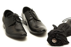 Classic black men's shoes with umbrella Stock Photos