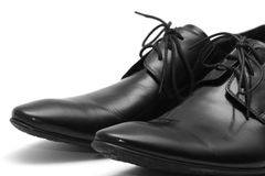 Classic black men's shoes on white background Royalty Free Stock Photo