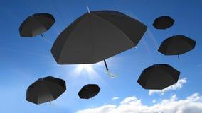 Classic black open umbrellas on blue sky Stock Images