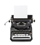 Classic Black Typewriter. Classic vintage black typewriter isolated with paper Stock Photo