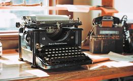 Classic Black Typewriter on Brown Wooden Desk Stock Images
