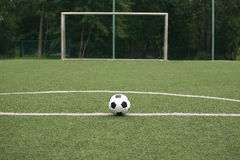 Classic black and white ball for playing soccer on sports ground Royalty Free Stock Image