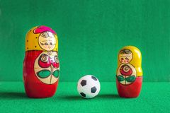 Classic black and white Football soccer ball and three red yellow russian nesting dolls Stock Image