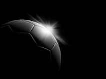 A classic black and white soccer ball. On black background Stock Photography