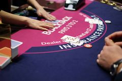 Classic blackjack game with chips and cards. Classic traditional blackjack game with chips and cards on the table Stock Images