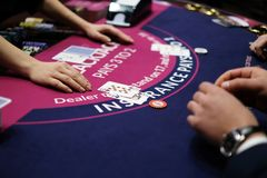 Classic blackjack game with chips and cards. Classic traditional blackjack game with dealer and players and chips and cards on the table Royalty Free Stock Photos